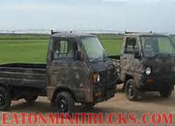 Mitsubishi 4x4 mini truck with 4 inch lift vision wheels 23 inch tires