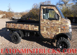 4 inch lift kit on Suzuki mini truck with weed n reeds camo wrap