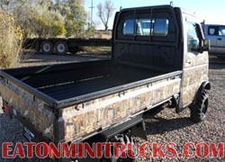 Black Rhino Lining on a Suzuki mini truck with Weeds N Reeds Camo wrap