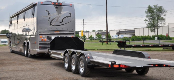 Diamond C Custom Triple Axle Hydraulic Tilt w/ Extension Ramps & Stationary Deck Triple axle with polished aluminum wheels. 10′ Stationary deck behind air dam for bike storage. 28′ Hauler. 18′ Hydraulic Tilt-deck. Extension ramps for loading vehicles with lower clearances.