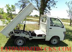 scissor lift dump truck on a 4x4 mini truck