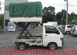 custom built scissor lift on a 4x4 mini truck