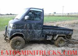 mini truck in the mud low range 4x4 four wheel drive