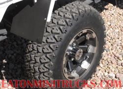 custom fender extensions and mud flaps on a mini truck